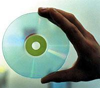 Hand Holding Clear Disc