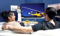 Couple Watching Panasonic HDTV/Blu-ray Player